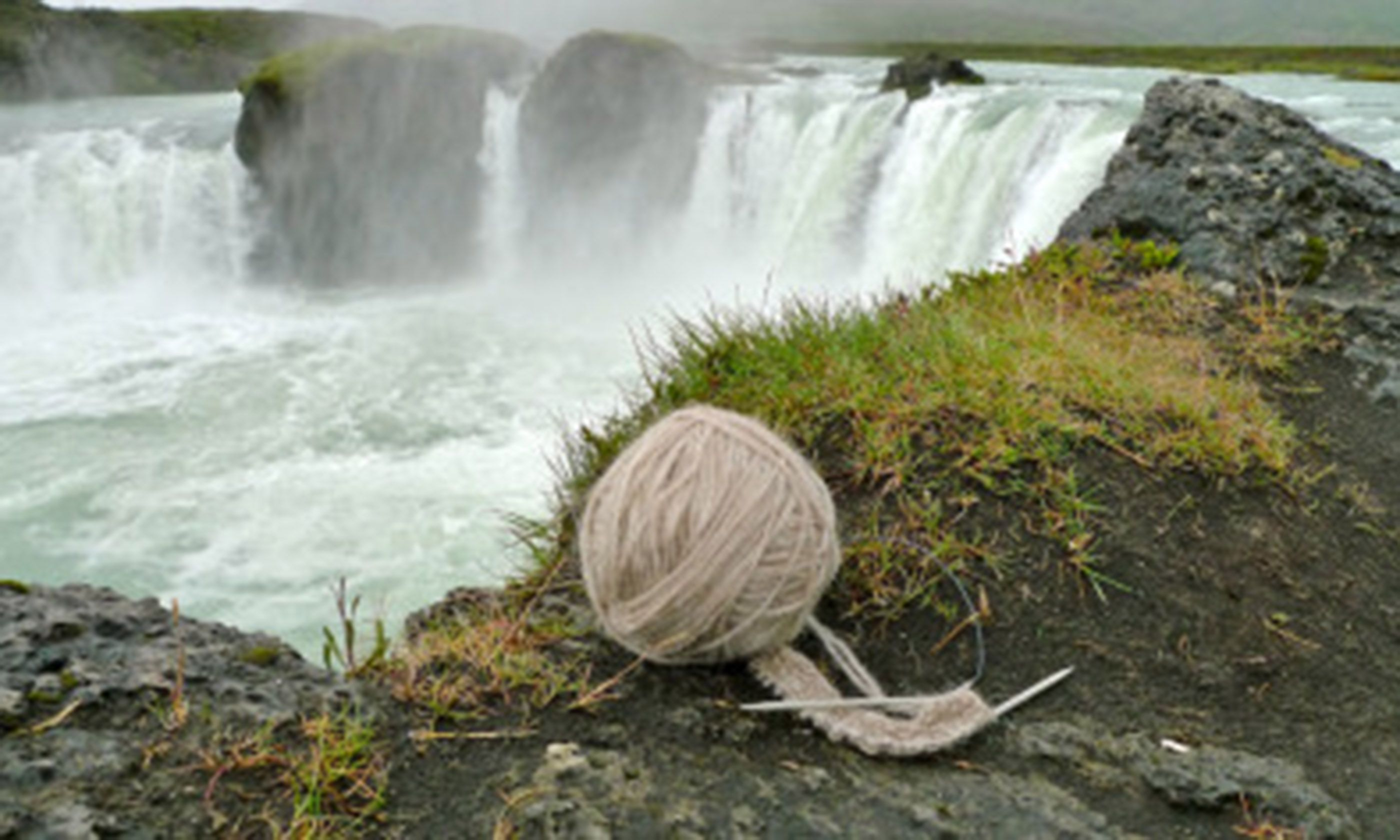 Knitting beside a waterfall (InspiredByIceland.com)