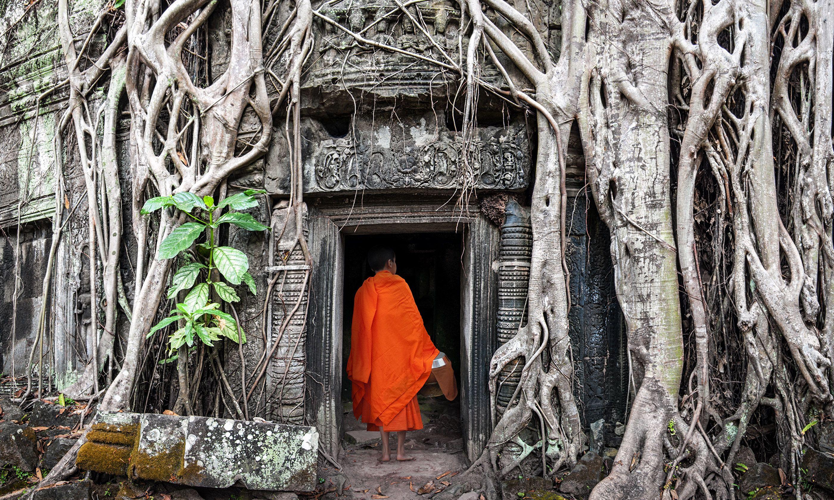 Monk entering temple, Angkor Wat (Shutterstock)