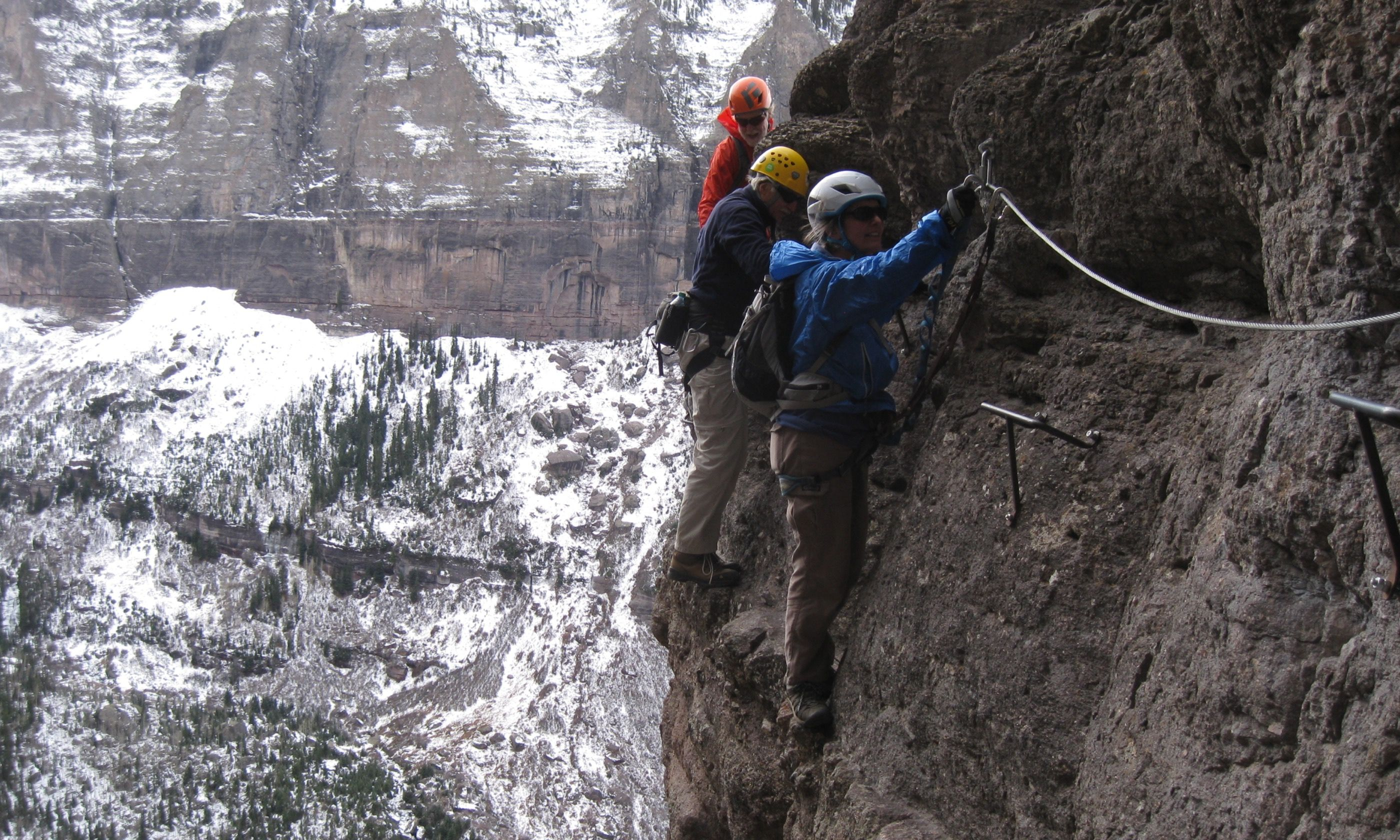 Climbers traverse along the via ferrata route in Telluride (Dreamstime)