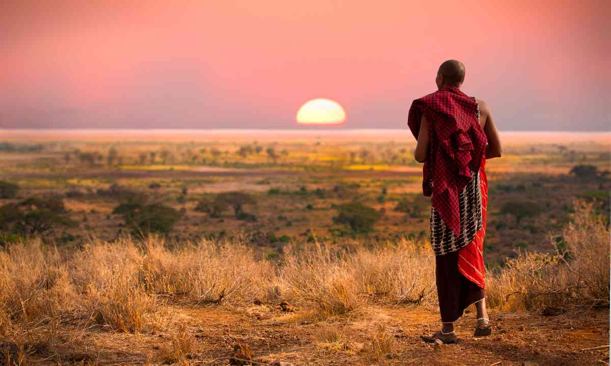 Maasai man looking across the Serengeti (Shutterstock)