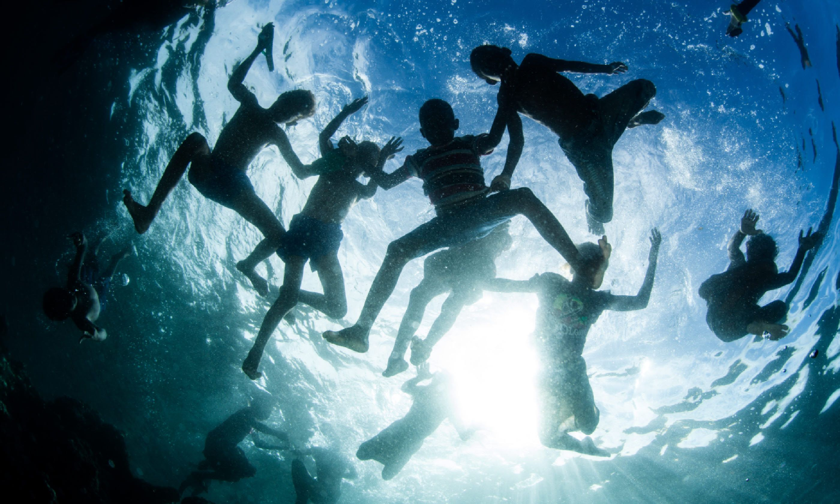 Children playing in the waters off the Solomon Islands (Shutterstock)