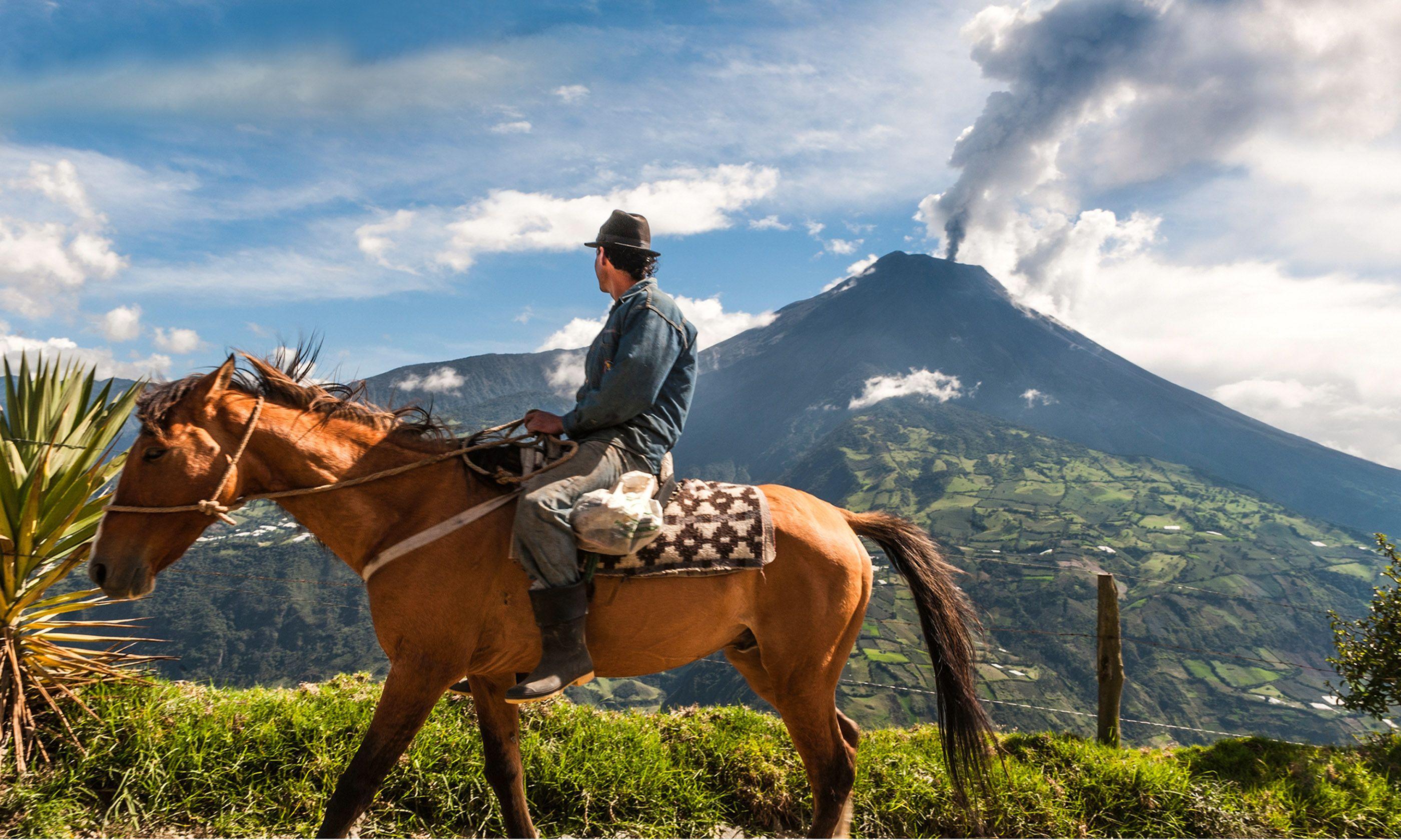 Farmer on horseback watching volcano erupt (Shutterstock.com)