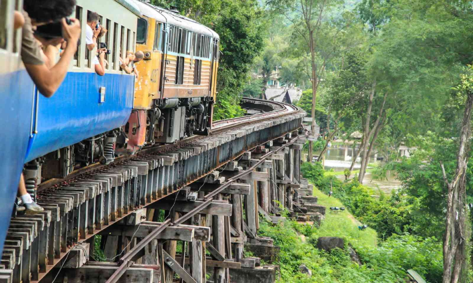 Thai Train on River Kwai Bridge of Kanchanaburi (Shutterstock)
