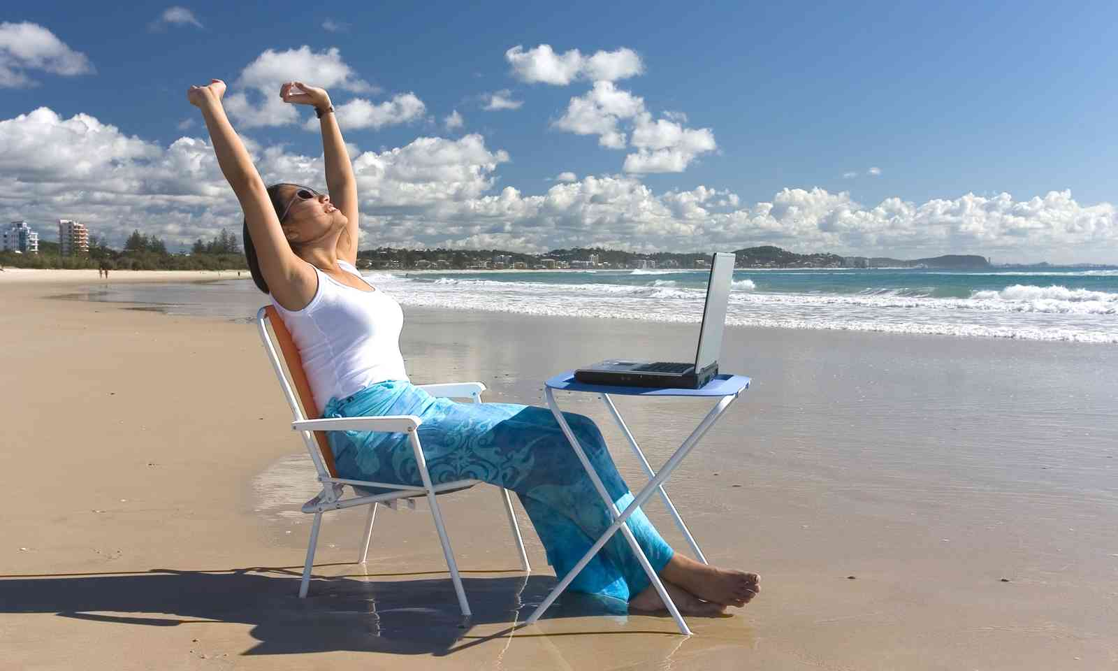 Working on the beach in Australia (Dreamstime)