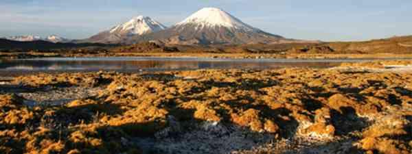 Pomerate and Parinacota volcanoes, Lauca (Turismo Chile)