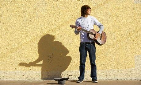 Young guy busking (Shutterstock.com)