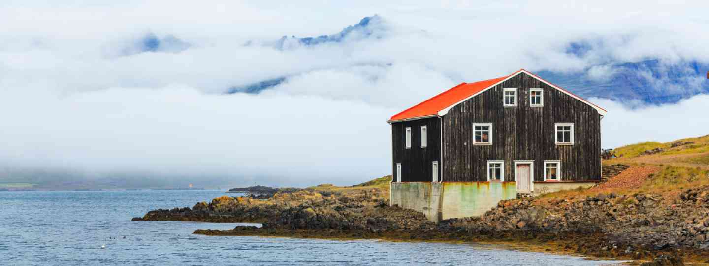 Black Wooden House at coastline in East Iceland (Shutterstock)