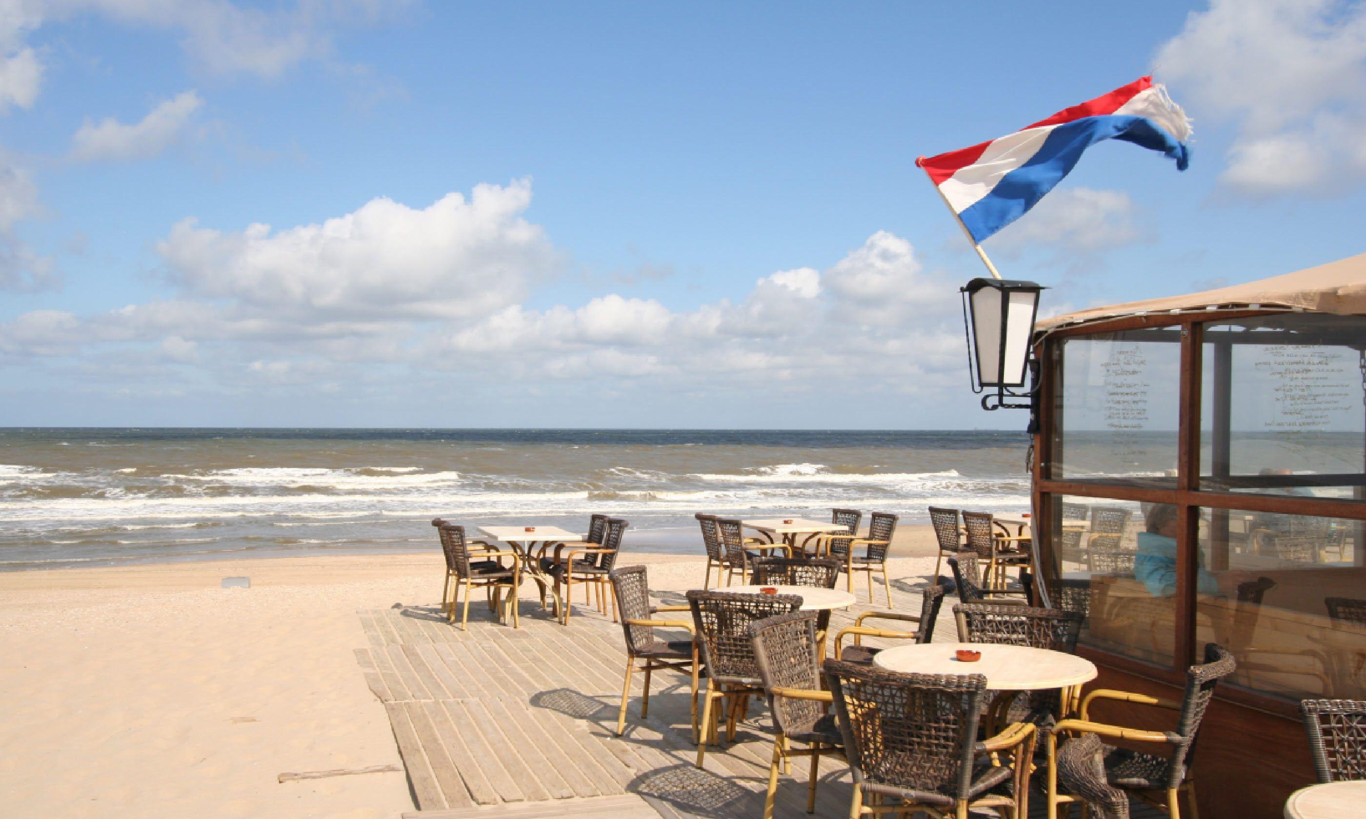 Beach restaurant with Dutch flag on the Dutch coast (Shutterstock)