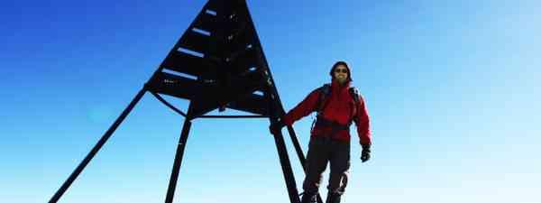 Climber on Toubkal summit (Shutterstock)