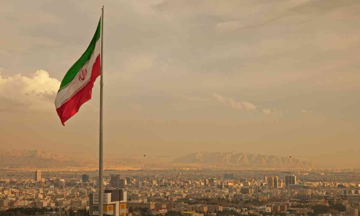 Iran flag in Tehran (Dreamstime)