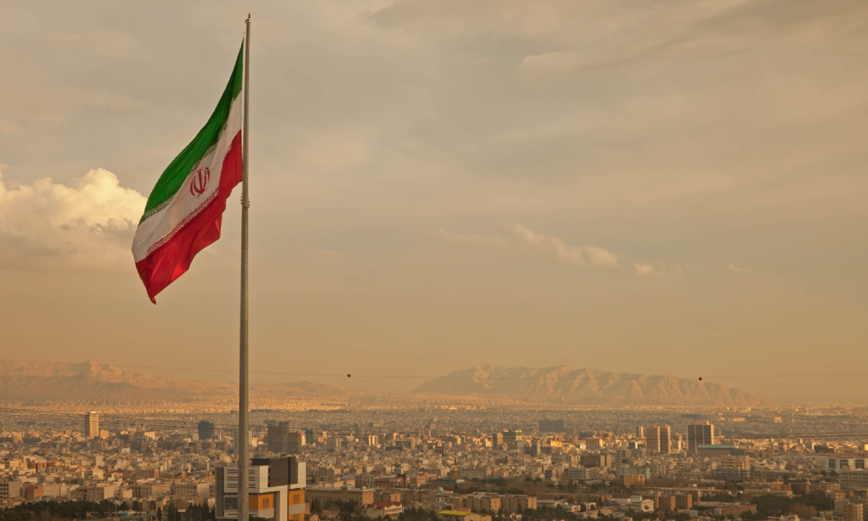 Iran flag in Tehran (Dreamstime)