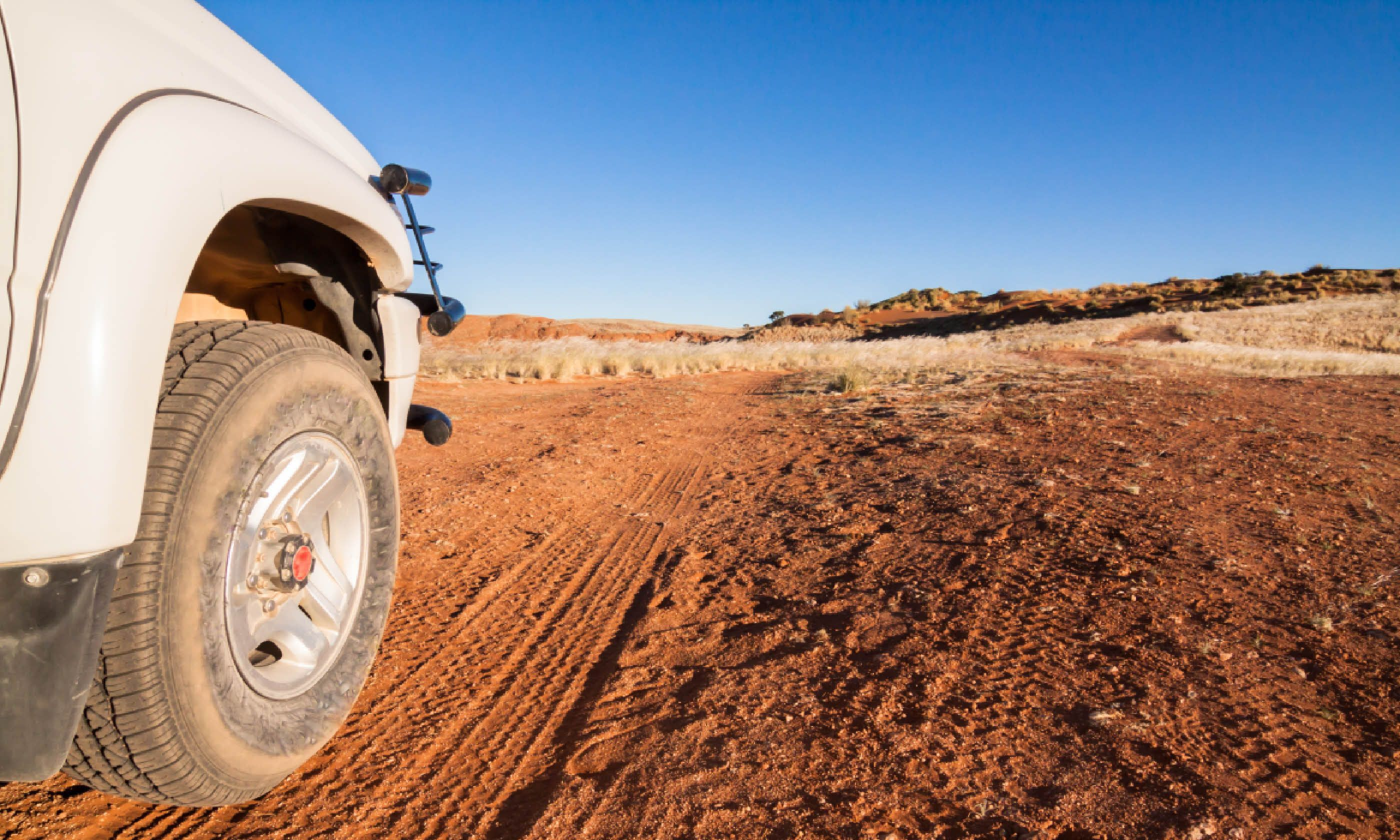 Car on sandy trail in Kalahari desert (Shutterstock)