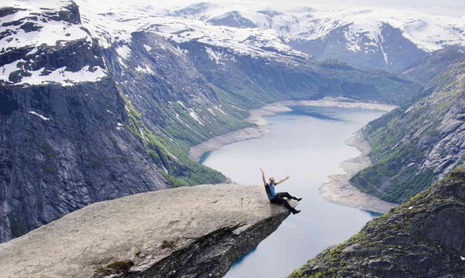 Dangling on the edge of Trolltunga (Neil S Price)