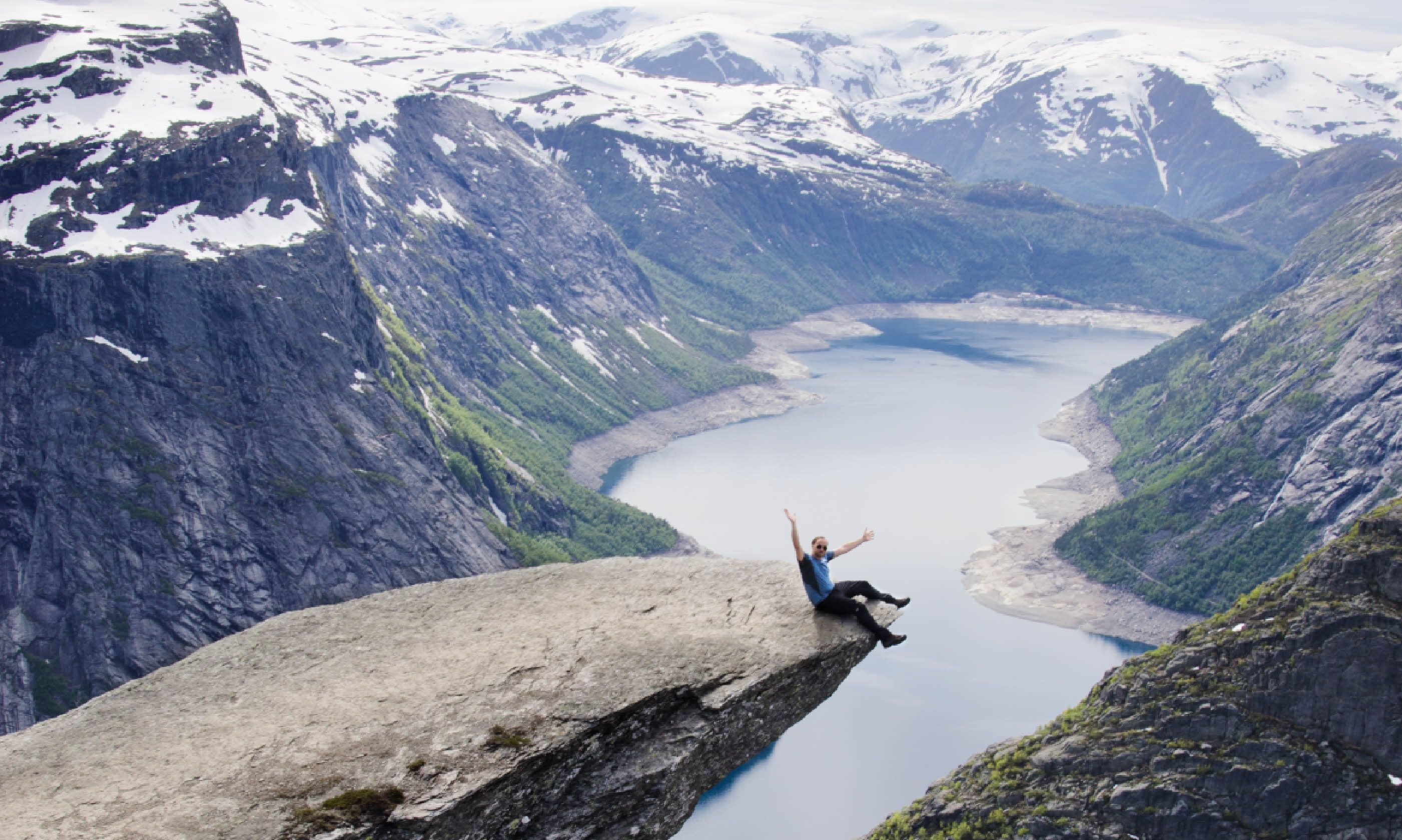Dangling on the edge of Trolltunga (Neil S Price)