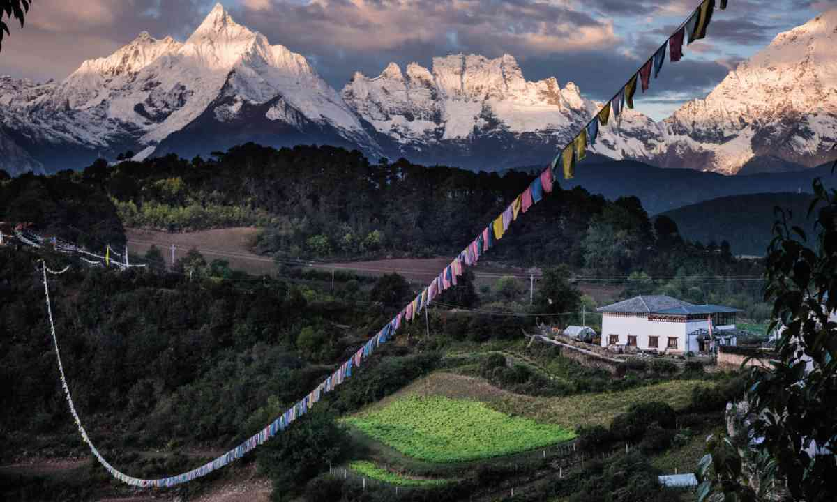Prayer flags decorate a village near Meili (David Abram)