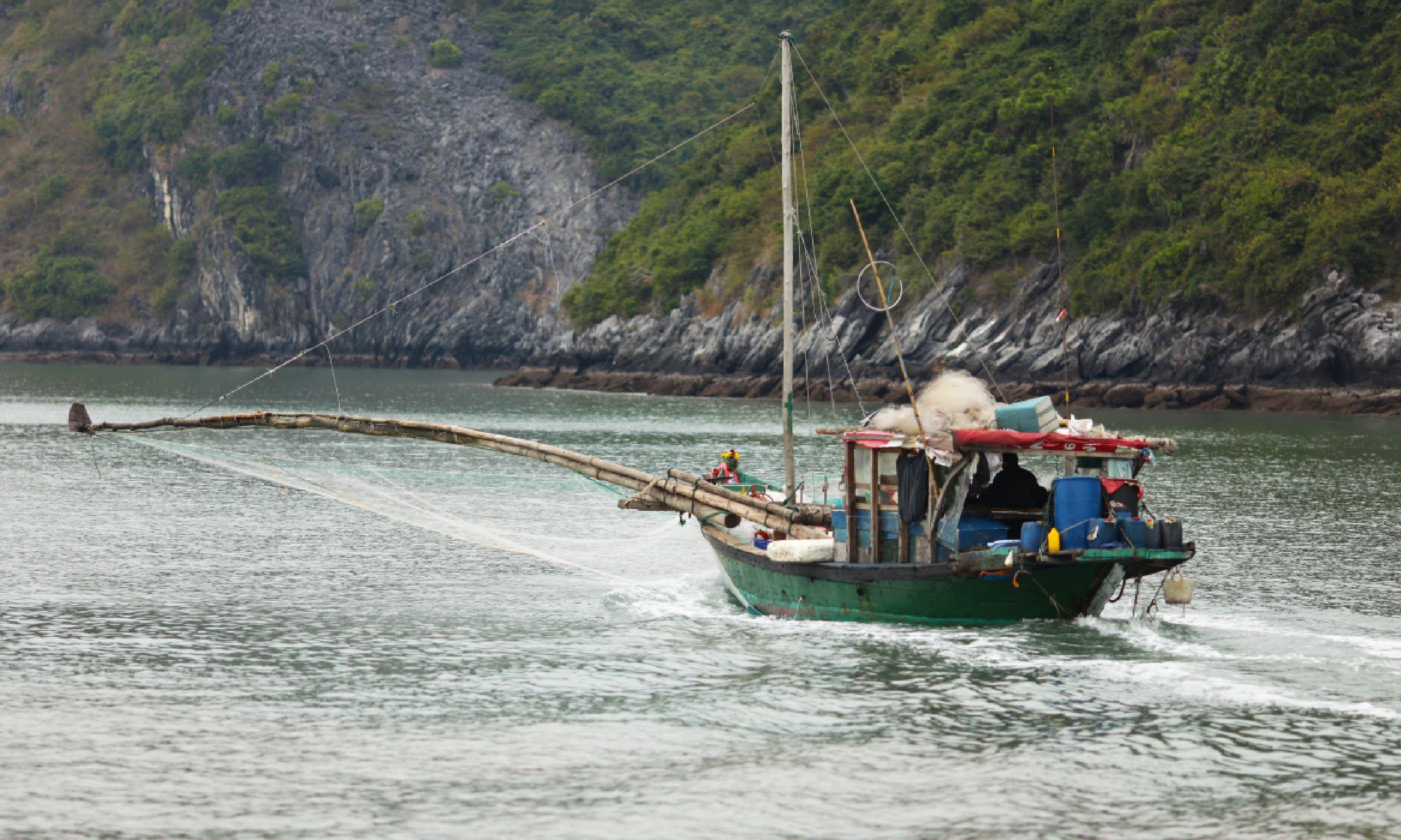 Fishing boat in Halong Bay (Dreamstime)