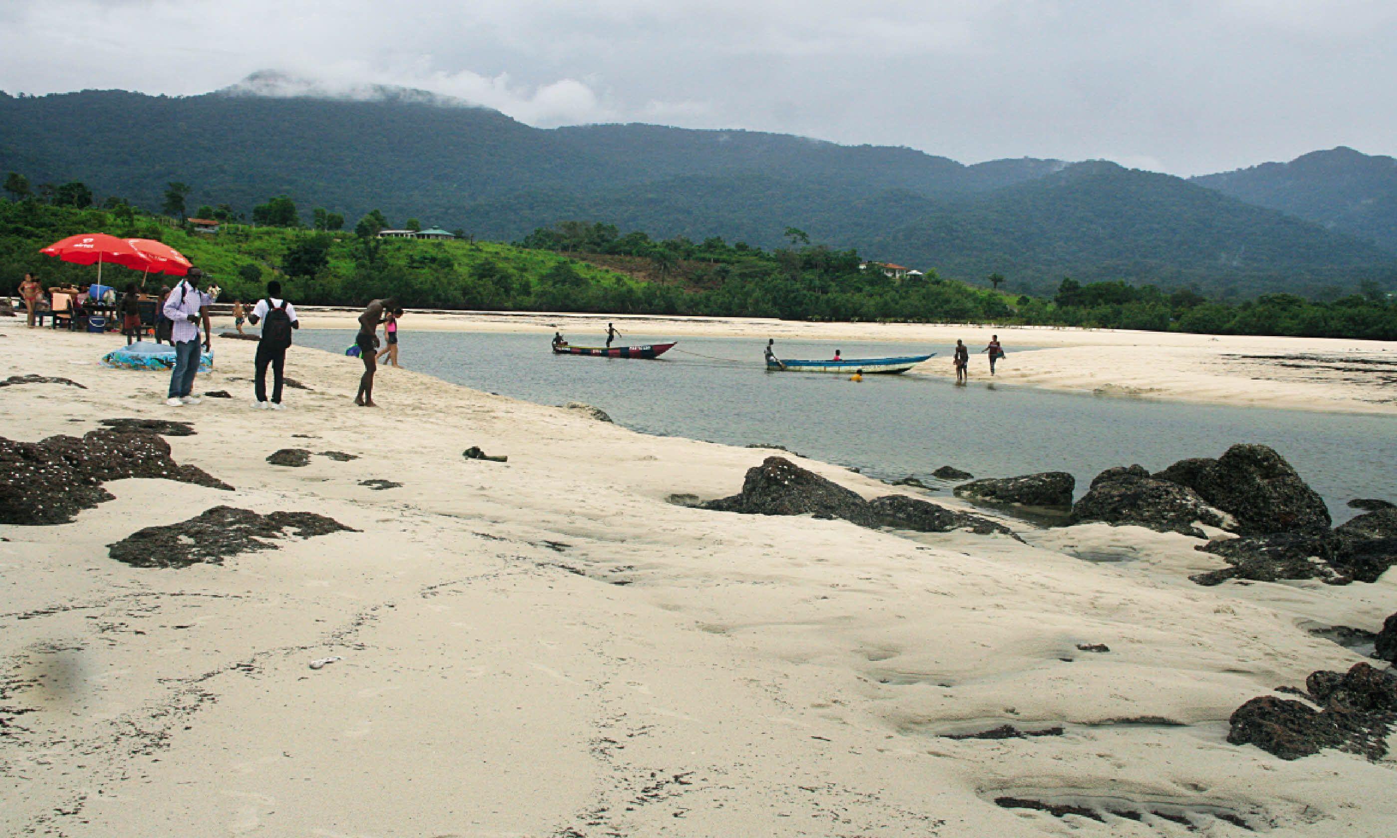 People enjoying the sandy shores of River Number Two (Nick Redmayne)