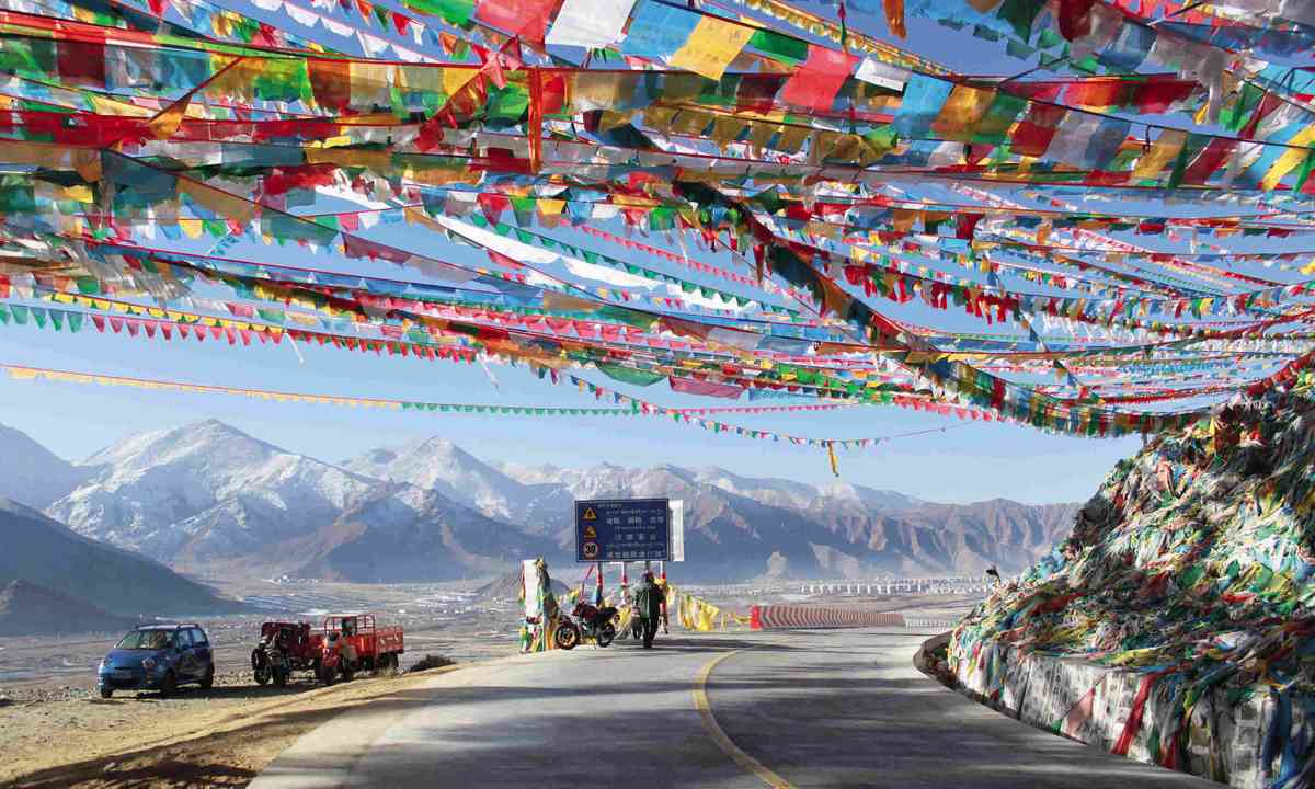 Flags decorate road in Lhasa (Tom Rhys)