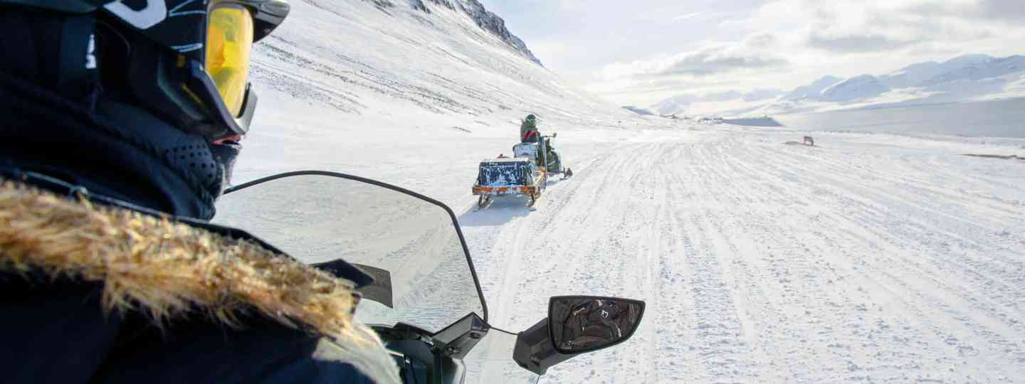 Snowmobiling in Arctic Norway (Neil S Price)