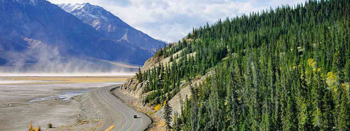 Alaska Highway cutting through National Park in Yukon, Canada (Neil S Price)