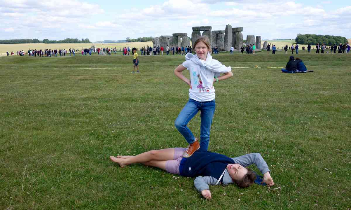 Kids playing at Stonehenge (Peter Moore)