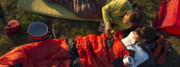 Trekking and overnight with sleeping bag (Shutterstock)