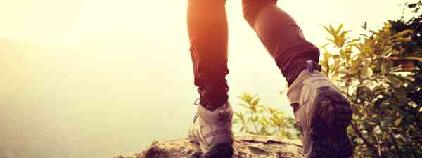 Female hiker on mountain (Shutterstock: see credit below)