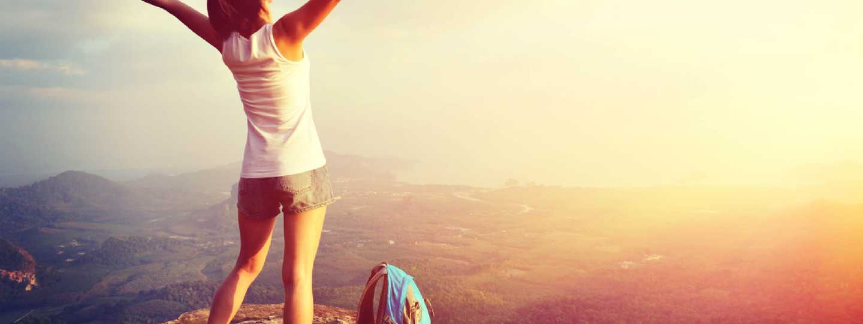 Hiker on mountain peak (Shutterstock)