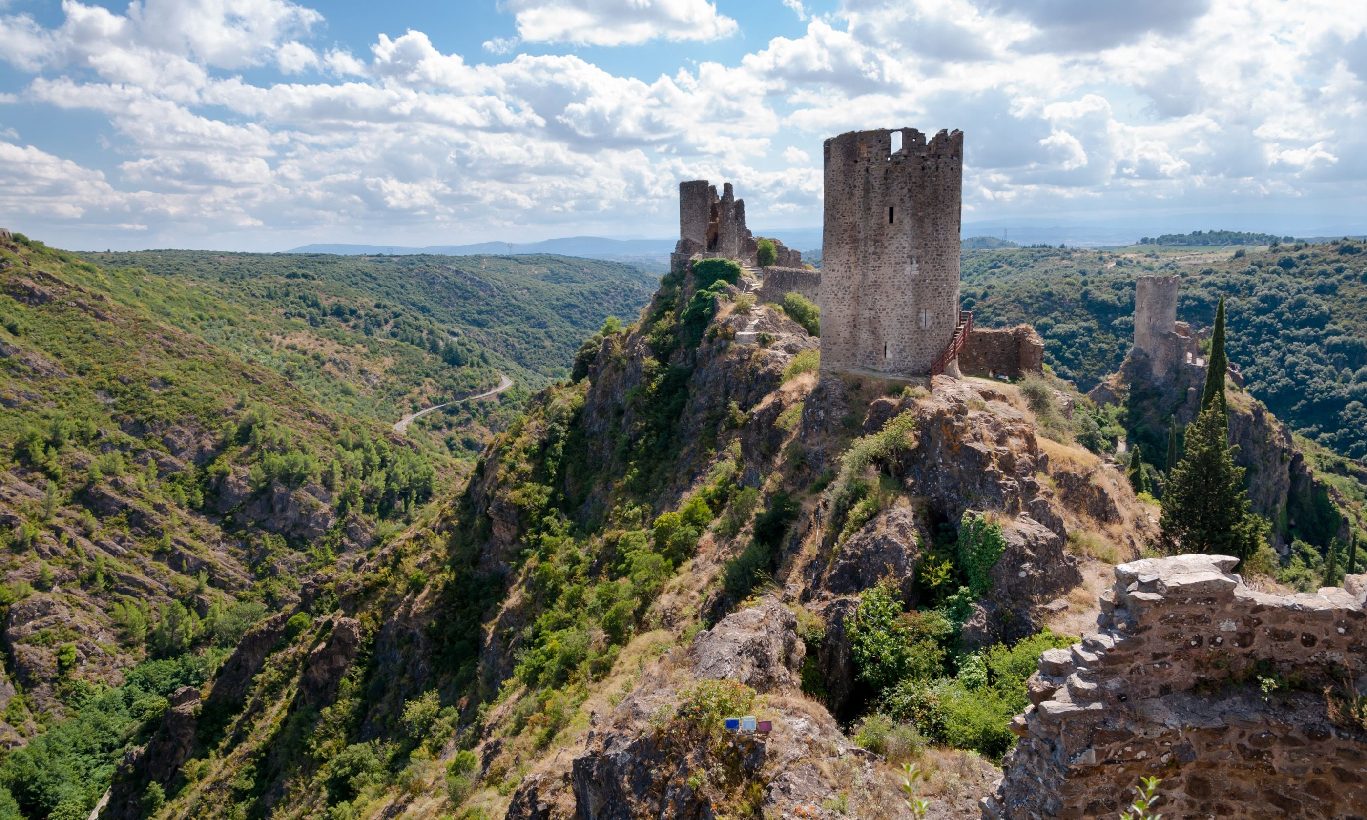 La Tour Regine Surdespine and Quertinheux towers and valley at Lastours in France. (Dreamstime)