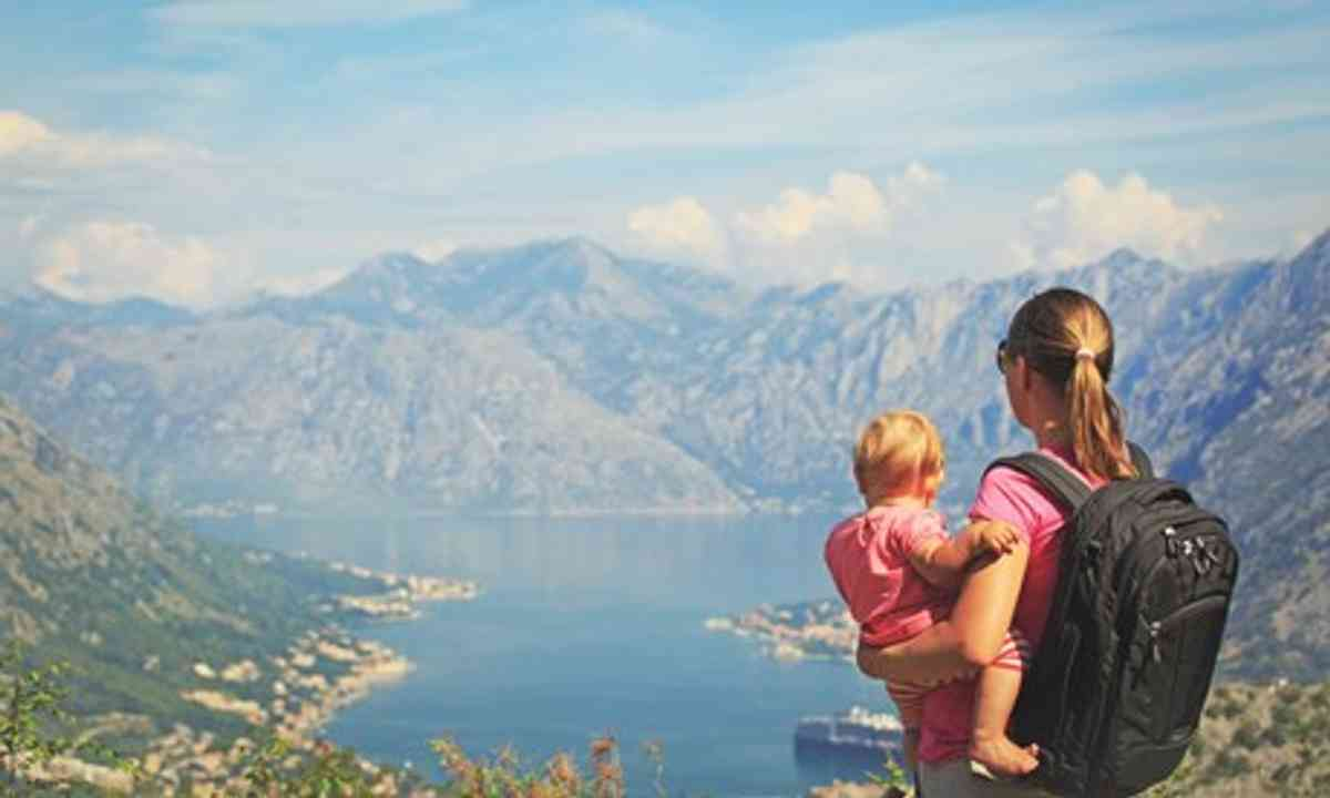 Mother and child looking across lake (Shutterstock.com)