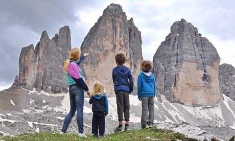 Family contemplating mountain in Italy (Shutterstock)