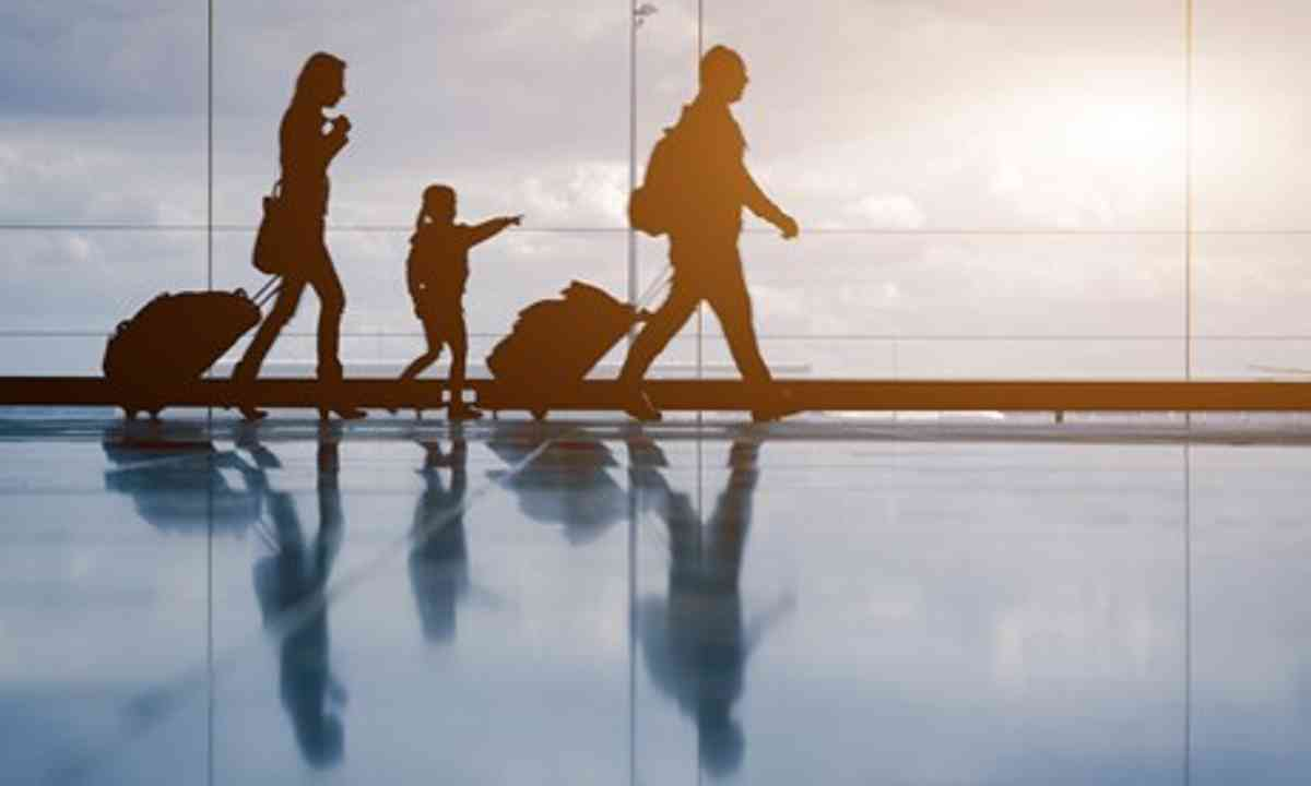 Silhouette of family at airport (Shutterstock.com)