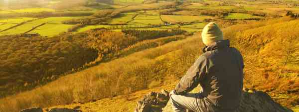 Hiker taking in the English countryside (Dreamstime)