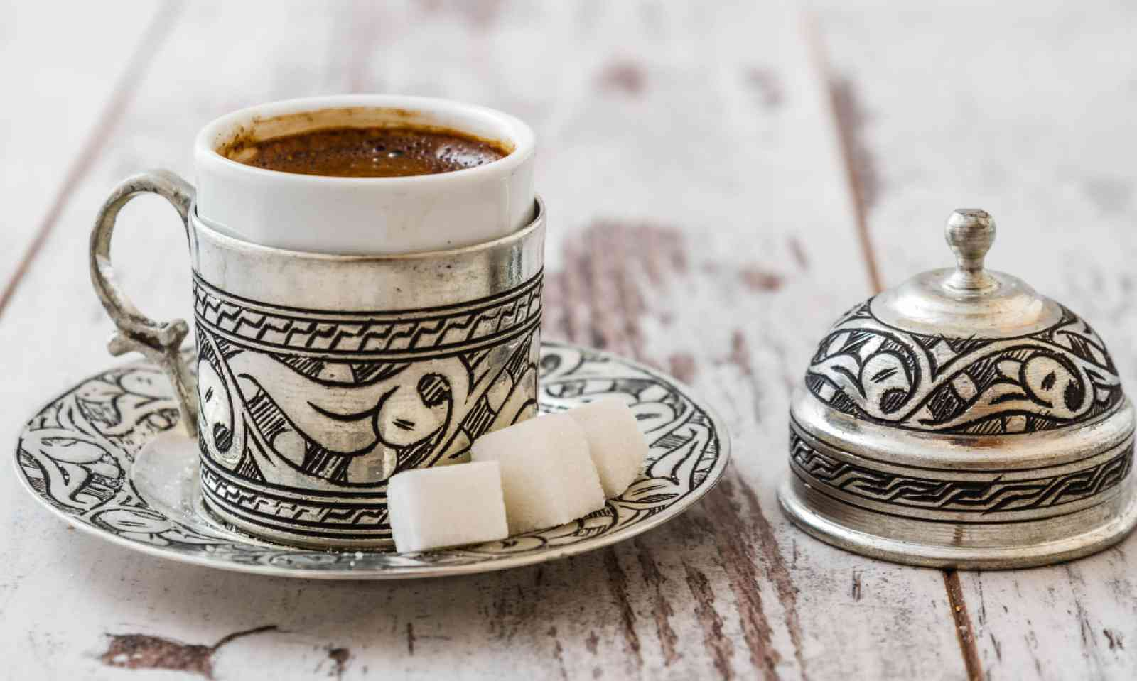 Turkish coffee served in a traditional silver cup (Dreamstime)