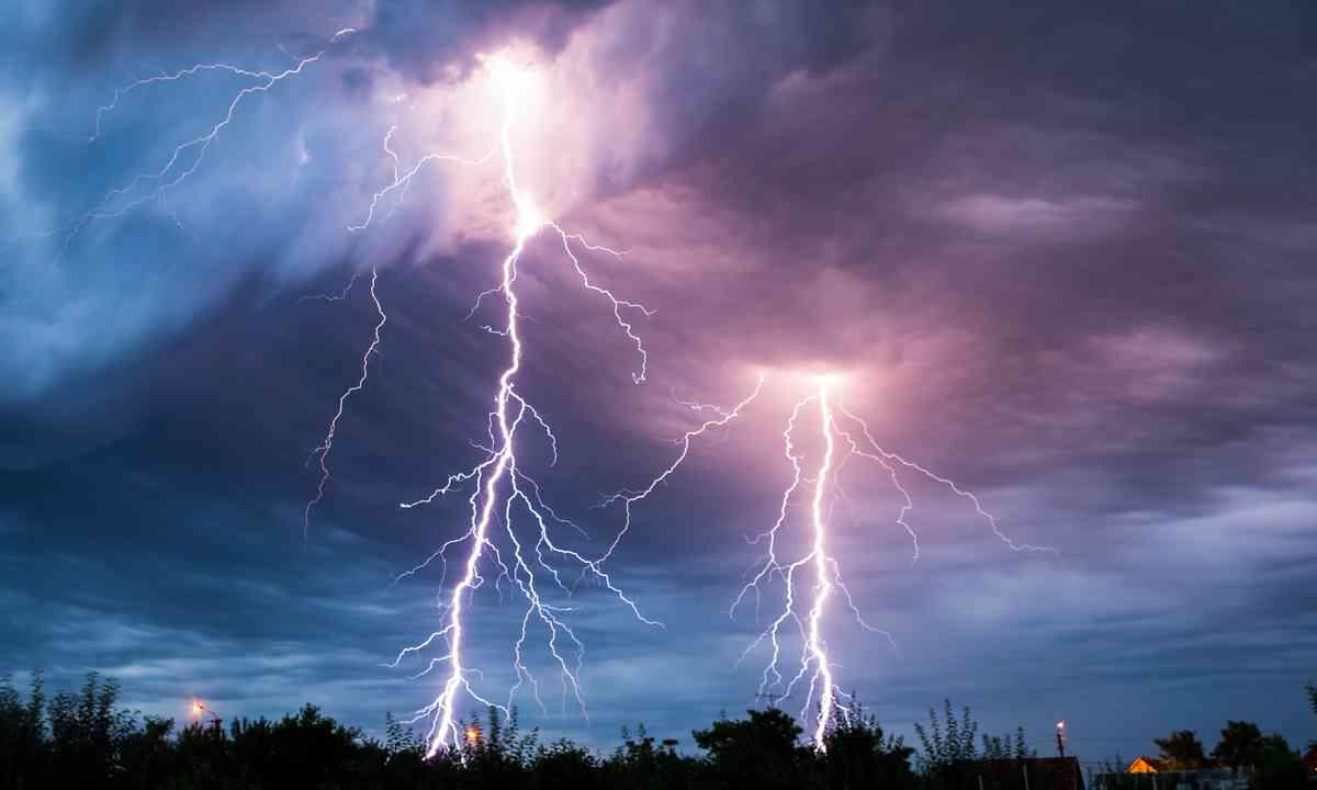 Lightning storm over forest (Shutterstock.com)