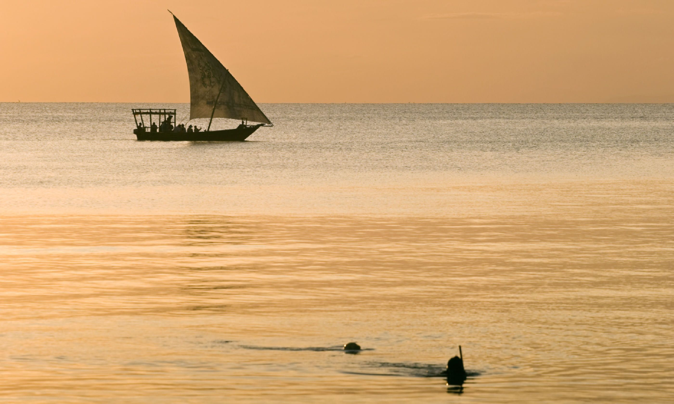 Sailboat and divers, Zanzibar (Shutterstock)