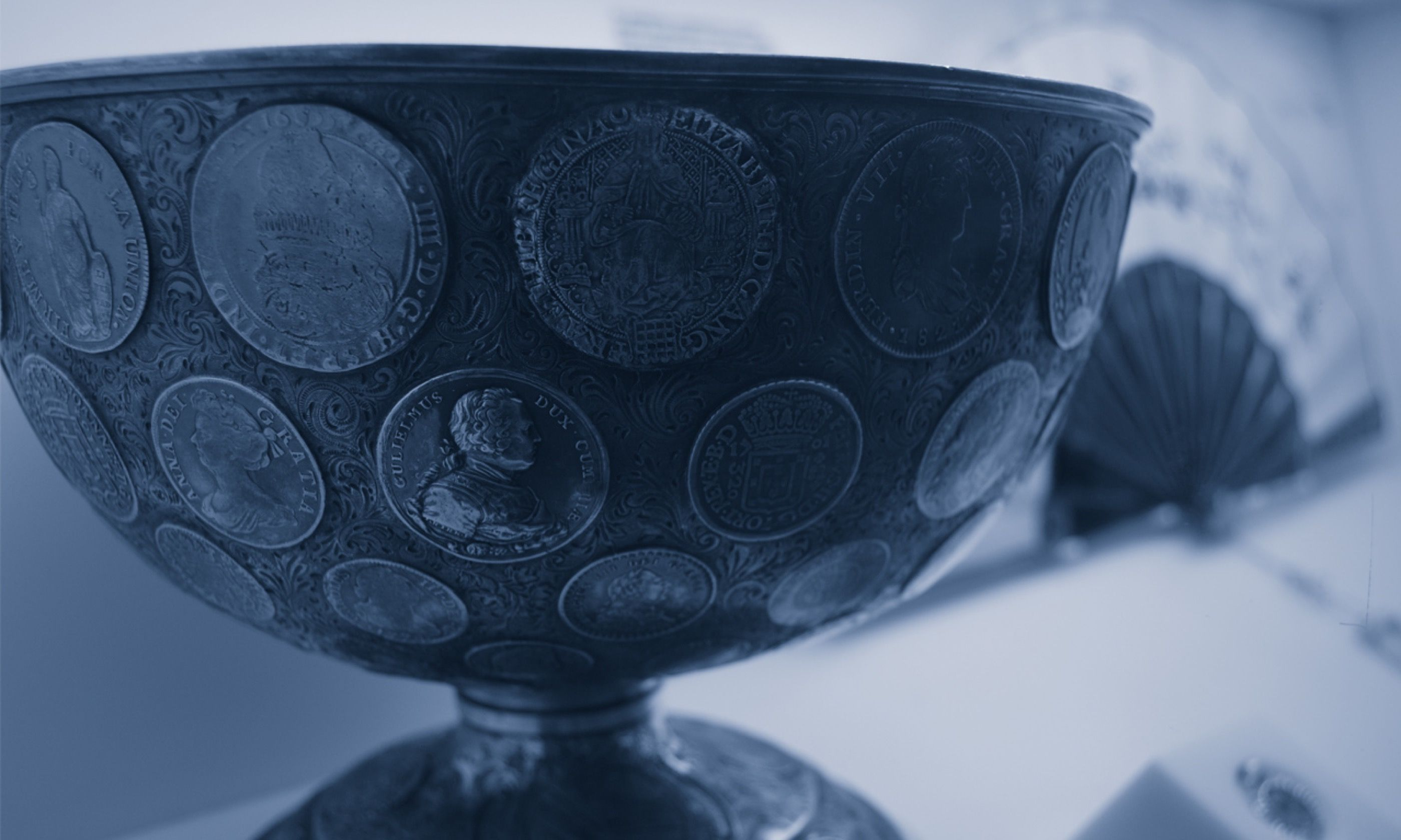 Coin encrusted cup (museudodinheiro.pt)