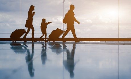Young family struggling to catch flight (Shutterstock.com)