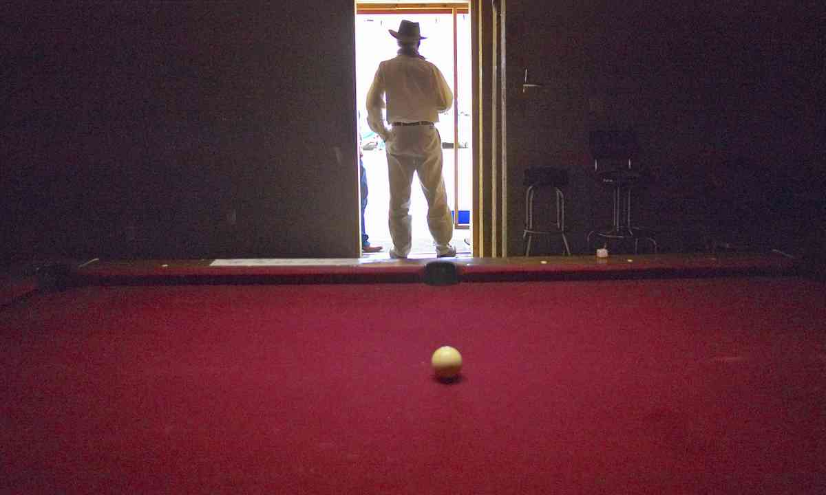 Playing pool in small town USA (Dreamstime)