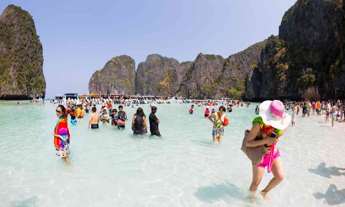 Tourist on the beach at Maya Bay, Phi Phi (Dreamstime)