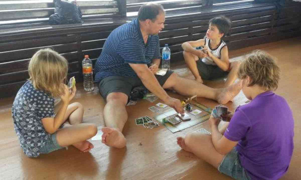 Cagol family playing cards on their travels (Edwina Cagol)
