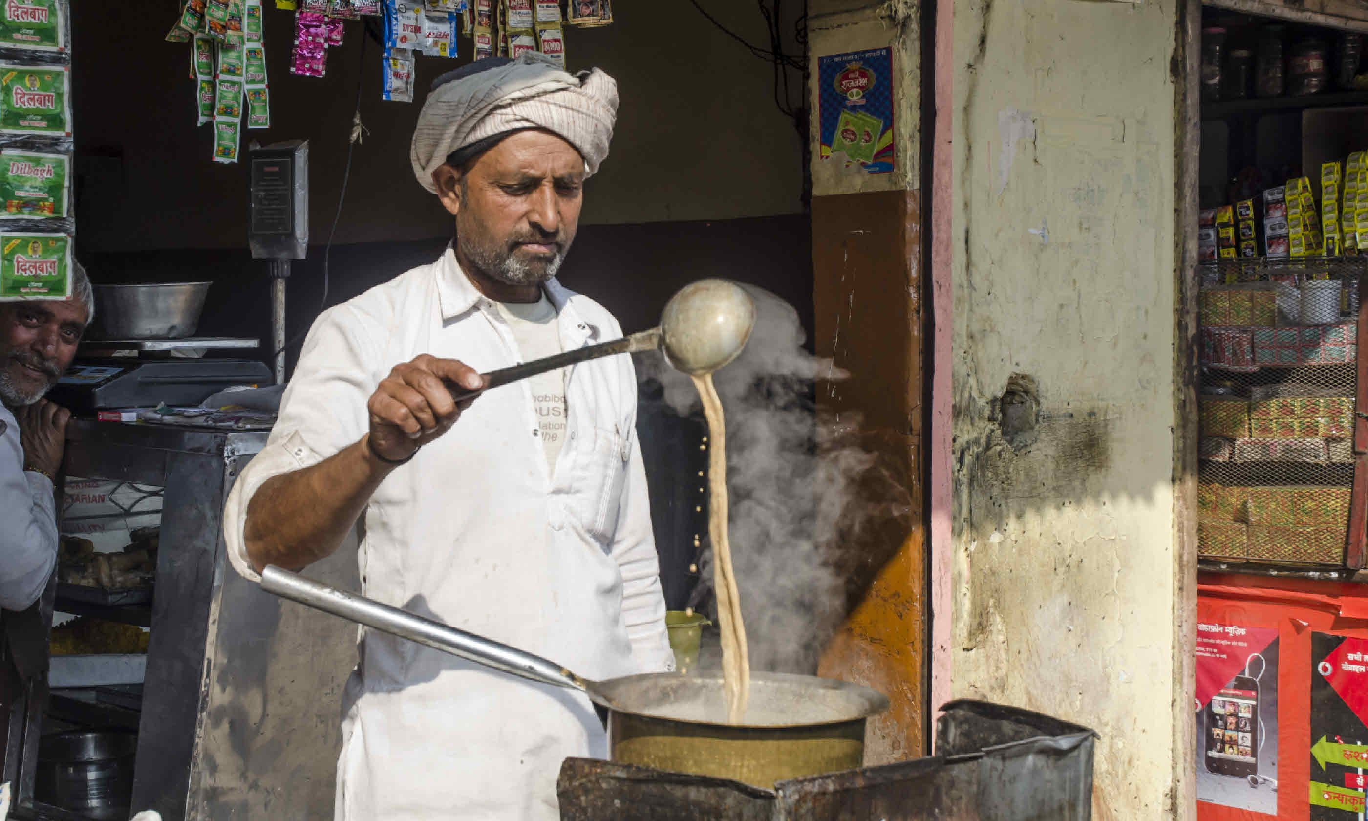 Man making Indian tea (Shutterstock)