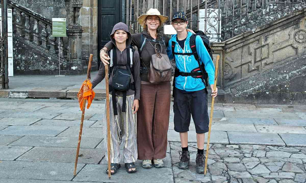 Melanie and her sons at the end of the Camino de Santiago (Melanie Gow)
