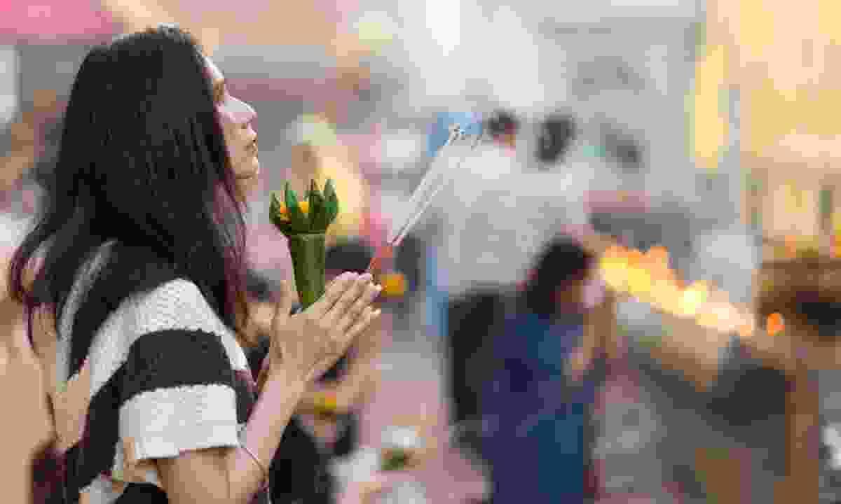 Buddhist prayer, Thailand (Shutterstock)