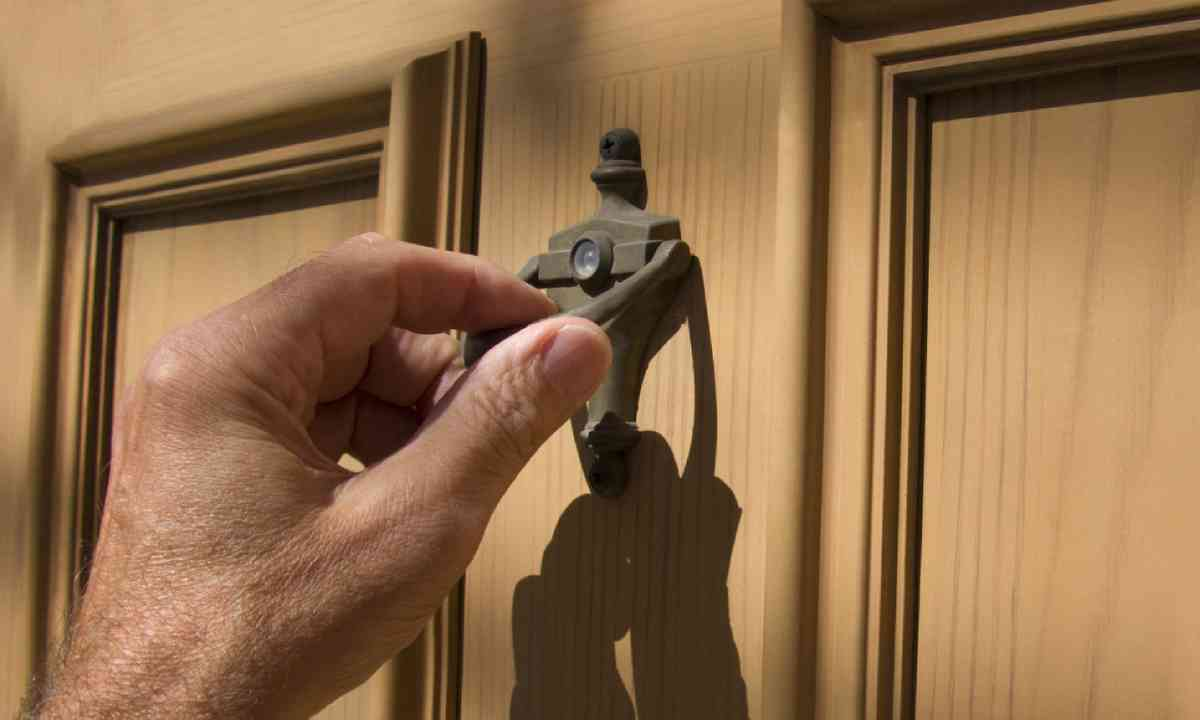 Hand on door knocker (Shutterstock)