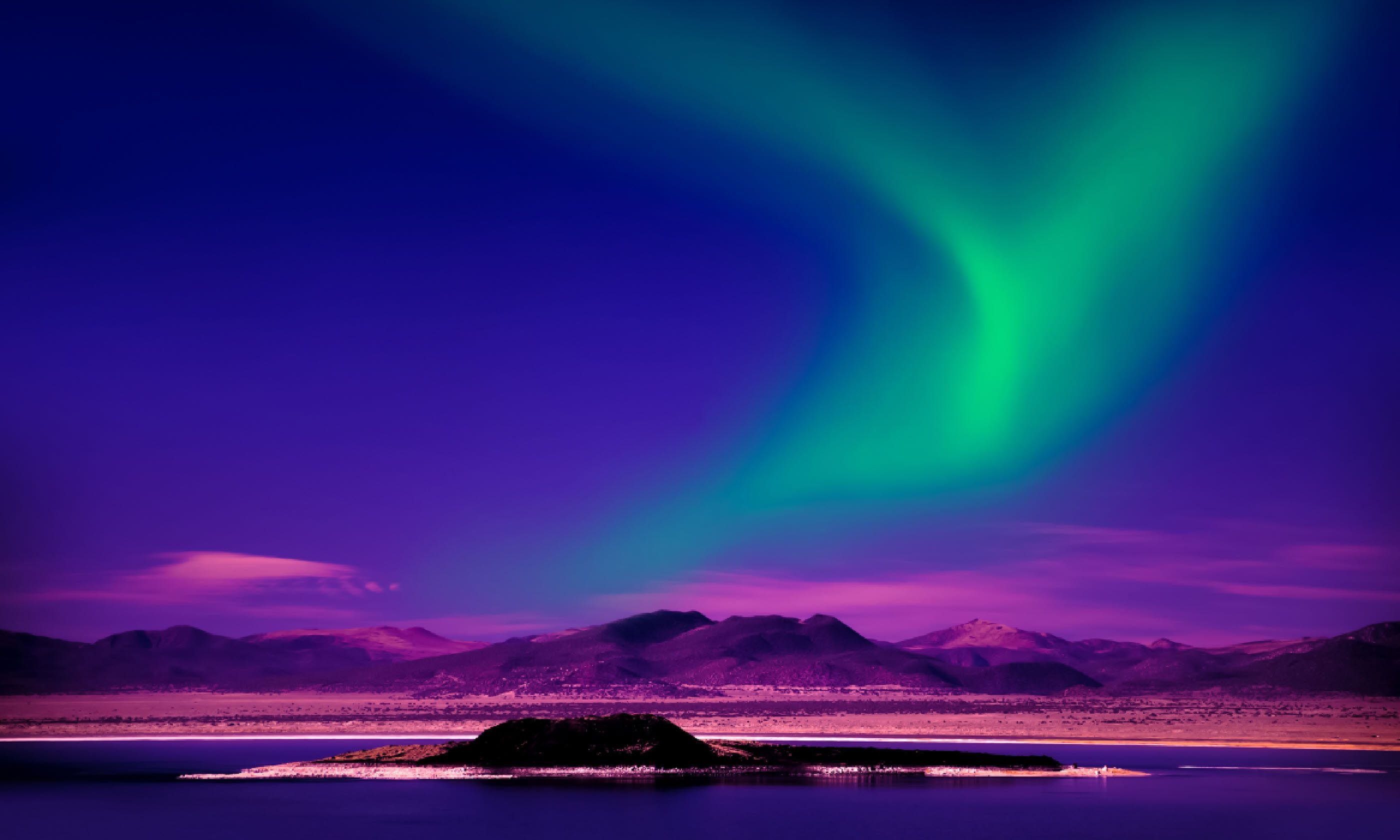 Northern Lights over lake (Shutterstock)