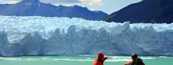 Couple looking at Perito Moreno Glacier, Patagonia (Shutterstock: see credit below)