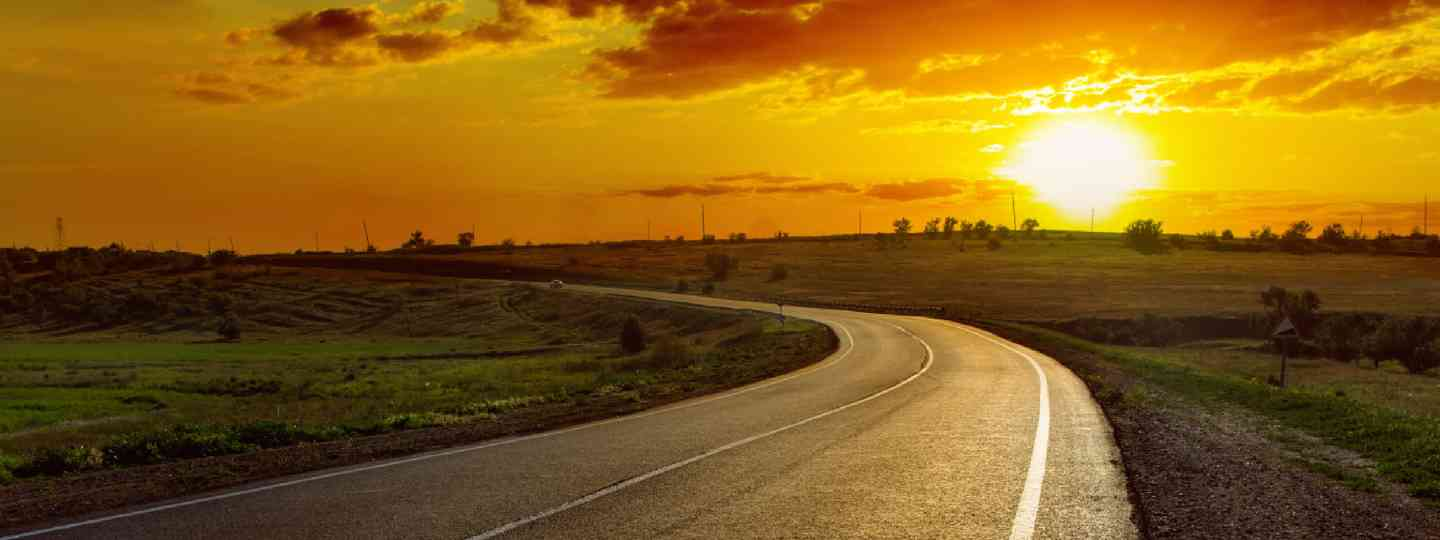 Sunset over asphalt road (Shutterstock)