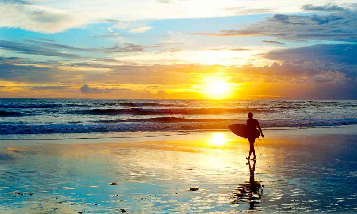 Surfer on the beach, Bali (Shutterstock)