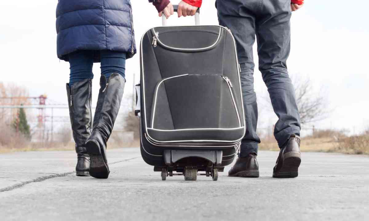 Pulling a suitcase (Shutterstock)